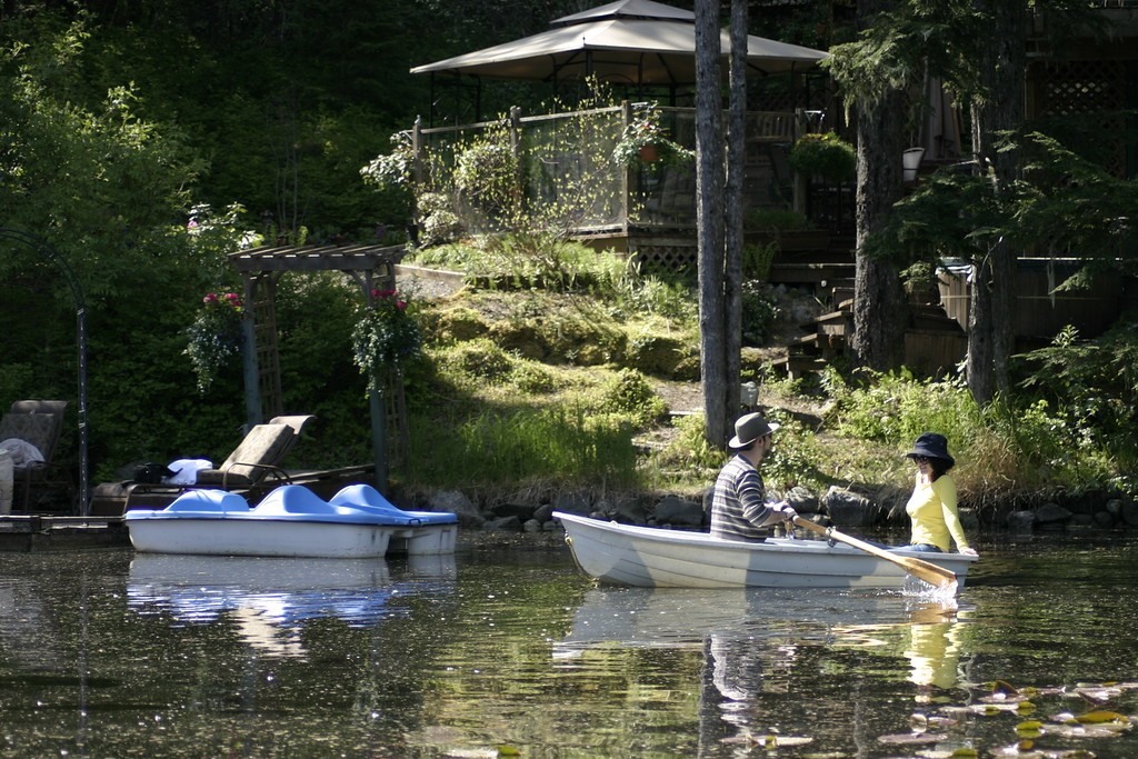 Complimentary Boats on Pond